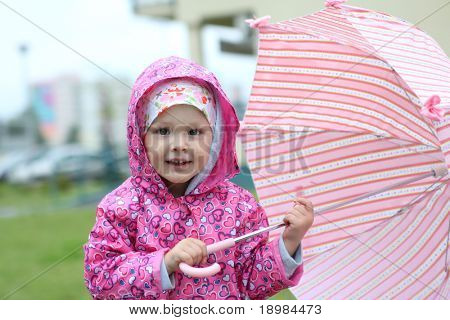 Little girl with pink umbrella