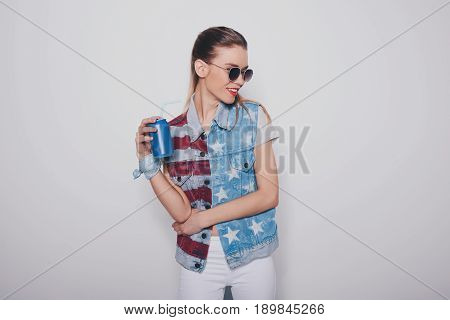 Stylish Hipster Blonde Girl In American Patriotic Outfit And Sunglasses Holding Soda Can Isolated On