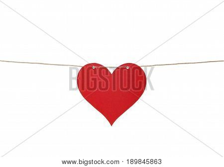 One heart of paper on a cord, isolated on white