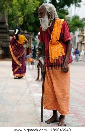 MADURAJ TAMILNADU INDIA - 08 JANUARY 2010: Indian pilgrims standing ahead of the temple in the Maduraj town in India