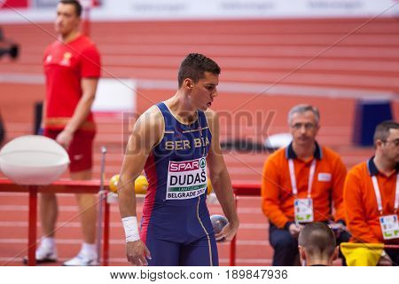 BELGRADE SERBIA - MARCH 3-5 2017: MAN HEPTATHLON SHOT PUT DUDAS MIHAIL EUROPEAN ATHLETICS INDOOR CHAMPIONSHIPS IN BELGRADE SERBIA