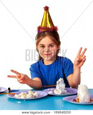 Birthday children celebrate party and eating cake on plate together. Portrait of three kids happy girl and boy in party hat sitting for table. Children got stained with festive cake. Child won the