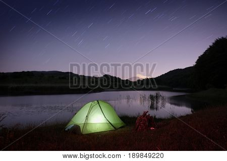 peaceful night on lake with tent in Nebrodi Park, Sicily