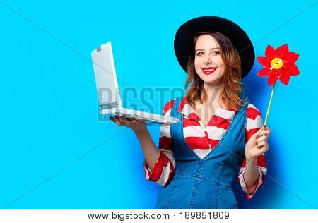 Woman With Laptop And Pinwheel