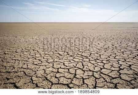 Dry cracked desert. Theme of the global shortage of water on the planet.