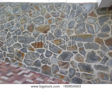 Stone clad wall and newly laid pavement in andalusian village