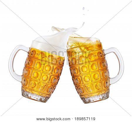 two mugs of beer toasting creating splash isolated on white background. Pair of beer mugs making toast. Beer up. Golden beer splash