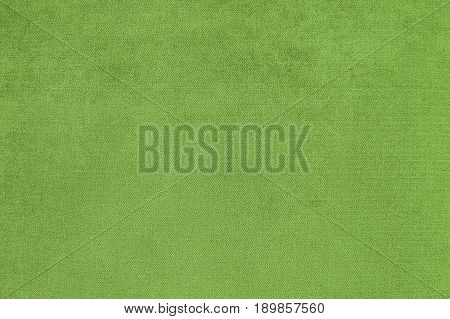 Background with green texture velvet fabric close-up