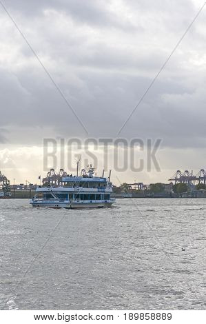Boat With Tourists Goes On Elbe River In Hamburg, Germany