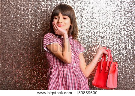 Small Pretty Happy Girl With Fashionable Red Leather Bag