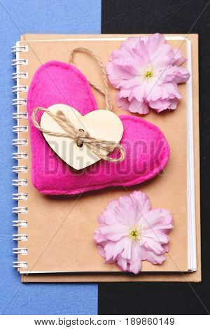 Heart In Pink Colour And Pink Sakura On Beige Notebook