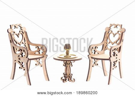 Chalice On Golden Stray On Vintage Table With Chairs