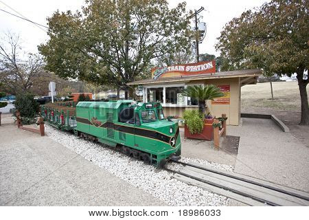 AUSTIN, TEXAS - DEC 7: The Zilker Zephyr train is parked at the train station on December 7, 2010 in Zilker Park, Austin, Texas. The Zephyr takes riders on a scenic ride around Zilker park.