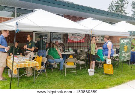 Mead, WA - June 3, 2017: Fire station 92 Mead, Wellness day demonstrations, Spokane Scope North volunteers doing Children's ID program