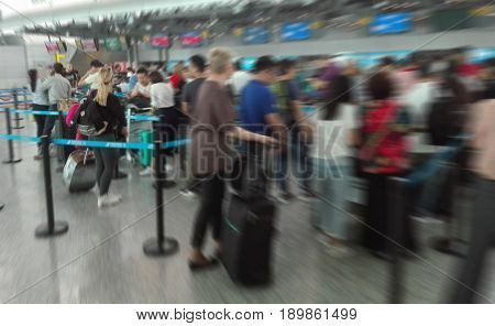 Abstract Blur Background Airport Check-In Counters With Many Passengers in queue With Bokeh