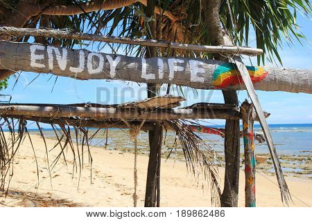 "Travel To Island Koh Lanta, Thailand. An Inscription ""enjoy Life"" On The Wooden Abandoned Hut."