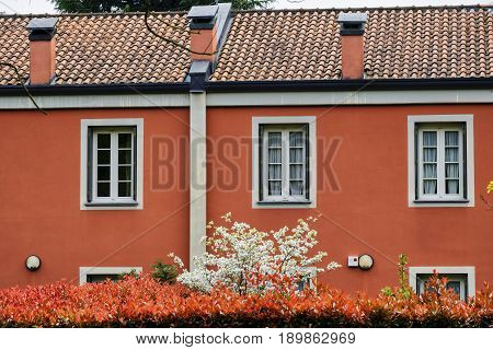 Red facade of building along the bicycle path of the Lambro valley (Monza Brianza Lombardy Italy) at spring