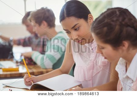 Two students studying in classroom at school