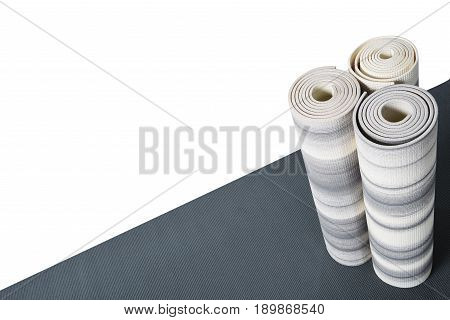 Yoga Mats Standing On Grey Mat Isolated On White With Copy Space