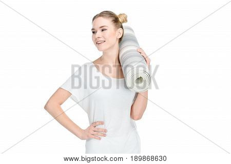 Attractive Blonde Girl In White Sportswear Holding Yoga Mat Isolated On White