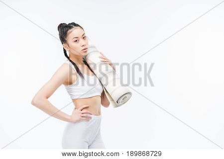 Attractive Asian Girl In Sportswear With Yoga Mat Standing Isolated On White