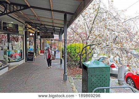 LEURA AUSTRALIA - SEPTEMBER 25 2015: Shops and pedestrians along Leura Mall the main thoroughfare through Leura a rural gateway to the Blue Mountains of New South Wales Australia on a rainy day.