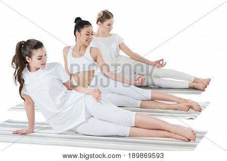 young women doing Side Plank Pose with mudra sign isolated on white