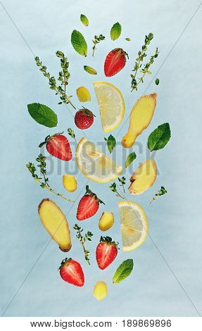 Summer Food and Drink - Fruit Lemonade Ingredient Pattern made of Strawberry, Ginger, Lemon, Fresh Mint and . Splash Shape with Flying Drink Ingredient. Summer Fruit Drink Ingredient Concept. Flat Lay