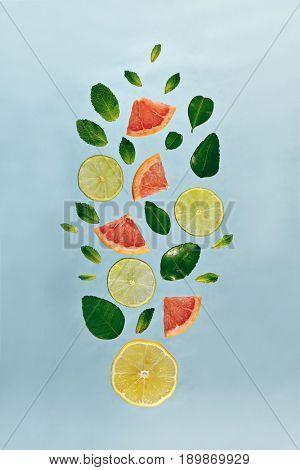 Summer Food and Drink - Fruit Lemonade Ingredient Pattern made of Lemon, Lime, Fresh Mint and Grapefruit. Splash Shape with Flying Drink Ingredient. Summer Fruit Drink Ingredient Concept. Flat Lay