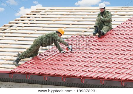 two workers on roof at works with metal tile and roofing iron poster