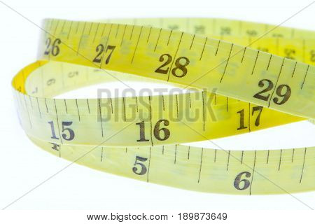Yellow Coiled Tape Measure Isolated On White Background