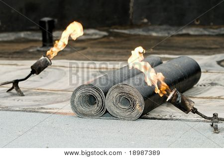 roofing felt roll and one torch blowpipes with open flame