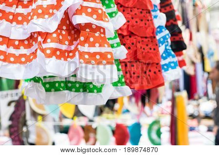 Flamenco dresses in a street market. Folklore.
