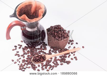 Coffee beans for drip coffee and black coffee in the glass jar coffee filter on white background.
