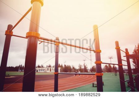 Sports area with bars and a bar at sunset in sunlight. Concept stadium.