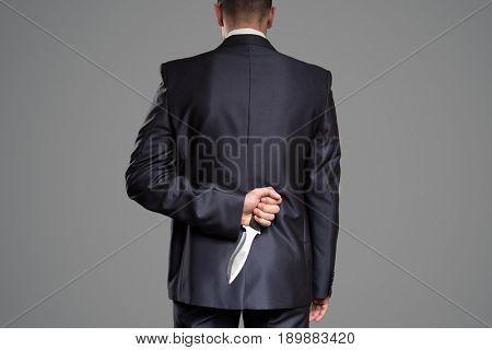 Man hide knife behind back. Killer concept.