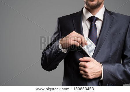 Concept bribe. Man take money.