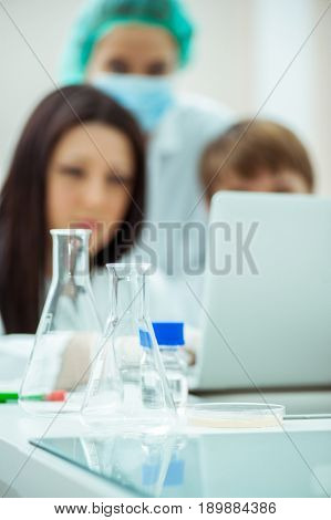 a group of lab experts working in a lab