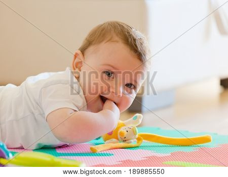 Toddler Plays On The Floor.