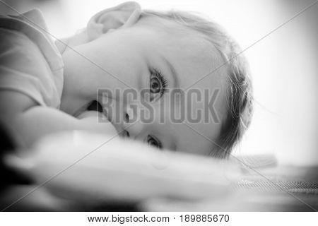 Black And White Portrait Of A Toddler.