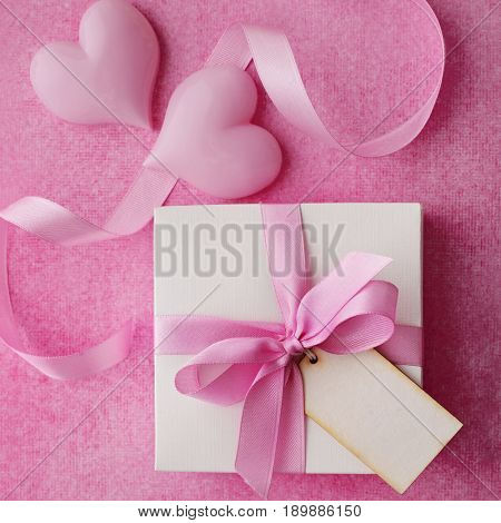 gift box with gift tag, pink ribbon bow