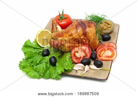 Appetizing grilled chicken with vegetables and herbs on a plate. White background - horizontal photo