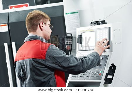 mechanical technician worker at cnc metal machining milling center in tool workshop