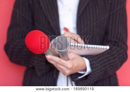 Reporter. News. Press conference. Media interview. Microphones. Journalism.