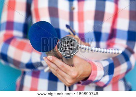 News. Journalist. Press conference. Media interview. Microphones. Journalism.