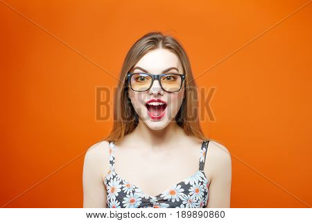 Screaming Female Model In Eyeglasses On Orange Background. Pretty Beautiful Brunette With Sensual Li