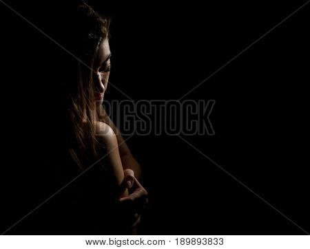 Woman Sexy Silhouette. Body scape of woman neck and hand on a dark background.