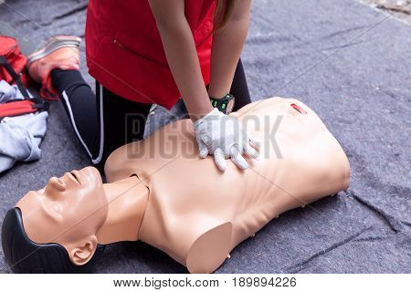 First aid training concept. CPR. Cardiac massage.