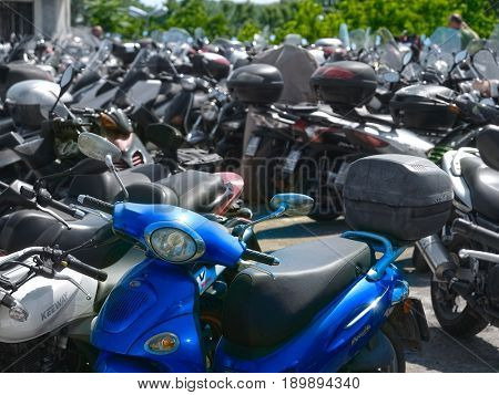Venice, Italy, May, 27, 2017: motorcycle parking in Venice, Italy. This parking is on the entrence of Venice. In this city not only cars or motorcycles, but bicycles cann't drive. Only boats.