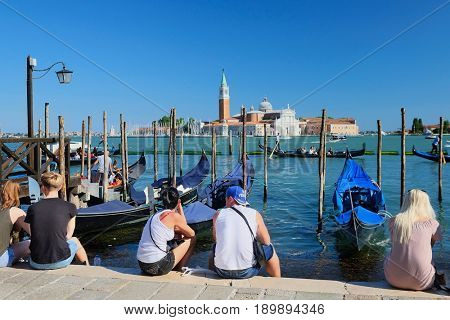 Venice, Italy, May, 31, 2017: landscape with the image of gondolas on a channel in Venice, Italy